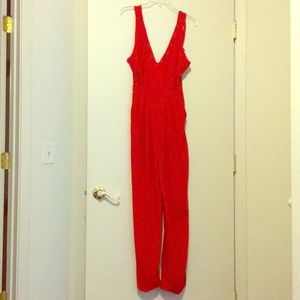 Guess Inc jumpsuit with lace size 2. Color Red Hot